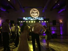 The bride and groom captured dancing. This couple selected my Pkg. 4 with the upgraded Photomontage and Gobo. Photomontage, Wedding Reception, Dancing, Groom, Monogram, Lost, Patio, Bride, Concert