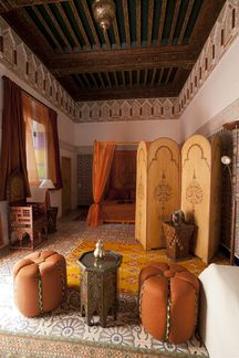 Morocco was a trade center for centuries and you can still see the influences of Arab, Spanish, and French cultures in this design style. This style is colorful, casual, and welcoming. Walls are generally heavily textured and painted rich colors. Textiles and tiles are common decorative elements and have bold geographic patters like stars or chevrons. Tiled floors commonly feature Persian rugs.