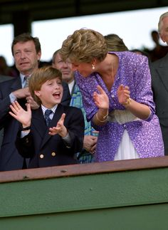 Prince William and Princess Diana applaud in the Royal Box at Wimbledon as Steffi Graf wins the Women's Singles Championship.