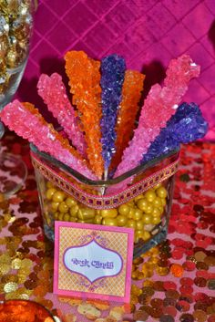 Easy DIY for baby shower/welcome baby party. Just a glass vase with bright candy filling bottom and add rock candy sticks in bright colors on top! Festa Tema Arabian Nights, Arabian Nights Prom, Arabian Party, Arabian Nights Theme Party, Arabian Theme, Aladdin Birthday Party, Aladdin Party, Birthday Party For Teens, Teen Birthday