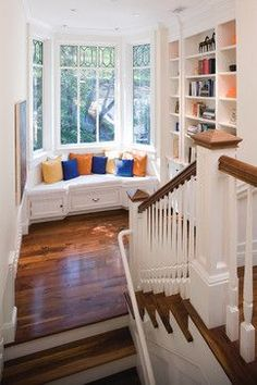 Staircase window seat and library