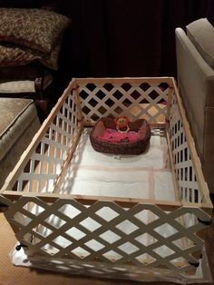 Playpen for small dogs made from plastic lattice, wooden frame and small tie down cords