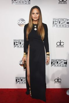 Chrissy Teigen in Yousef Akbar and Established Jewelry, with a Monique Lhuillier clutch