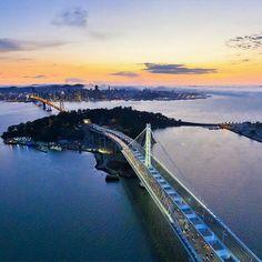 San Francisco-Oakland Bay Bridge with San Francisco in the background California. #SanFrancisco #Oakland #BayBridge #California #HeathrowGatwickCars.com