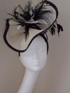 Sinamay/feather by AGATA TANISTRA #HatAcademy #millinery