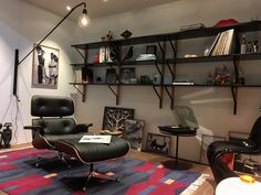 Vitra Eames Lounge Chair and the Prouvé Pontence Wall Lamp!