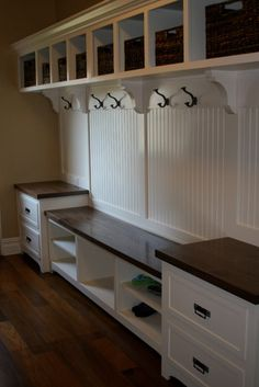 White and walnut built in unit for hall storage. Perfect for all those coats, shoes and bags. #storage #hall Designed by Jim Byers Construction. More info http://www.houzz.com/photos/1367951/General-Completed-Projects-traditional-laundry-room-chicago    In my dreams.....