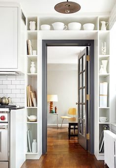 Cubbies around doorframe | white cabinets | hardwood floors