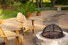 A patio of crushed granite fitted with stepping stones and a central fire pit. This cozy outdoor living space was installed in the midst of what was formerly a St. Augustine lawn.