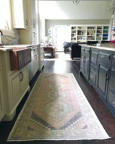 Farmhouse kitchen, vintage rug, oushak rug, two-toned kitchen, black and white…