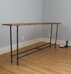 "DIY industrial pipe console table ~ certainly could be a DIY with PVC if it's going between the couch and wall, but the industrial pipe is sturdier for ""free-standing"" behind-couch situations. Diy Sofa Table, Sofa Tables, Bar Tables, Behind Couch Table Diy, Bar Table Diy, Pipe Table, Ideias Diy, Industrial Table, Industrial Lighting"