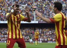 Barcelona's Brazilian forward Neymar da Silva Santos Junior (L) and Barcelona's Argentinian forward Lionel Messi (R) celebrate after scoring a goal during the Spanish league football match FC Barcelona vs Athletic Club Bilbao at the Camp Nou stadium in Barcelona on September 13, 2014.