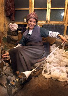 Traditional Weaver Prepares Rough Wool, Tibet Shear the sheep. Prepare the wool.  Twist into thread. Weave into beautiful rugs to warm the floors of Buddhist monasteries. Repeat for thousands of years.