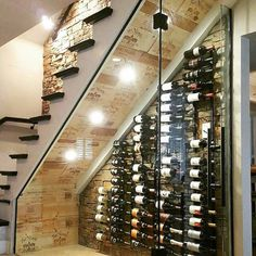 Old stairs in the house? No room for a cellar? Well check this idea out. Turn underneath your stairs into a wine cellar. note the cool use of wooden boxes lining the roof of the cellar. Under Stairs Wine Cellar, Wine Cellar Basement, Wine Cellar Modern, Wine Cellar Design, Home Stairs Design, Home Interior Design, Home Wine Cellars, Home Bar Designs, House Stairs