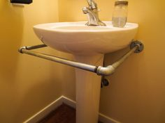 Down to Earth Style: How to Make a Pedestal Sink Skirt Rod