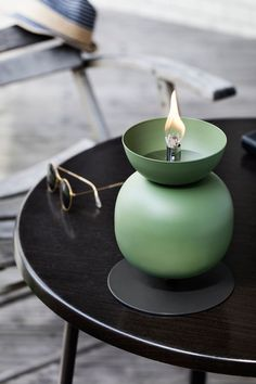 Frost Produkt sought inspiration in a field full of poppies when it came time to design the Poppy series of outdoor oil lamps for Northern Lighting.