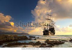 Pirátská loď na otevřeném moři při: stock fotografie (k okamžité úpravě) 1123137131 Ship Silhouette, Sunset Images, Fabric Wall Art, New Pictures, Royalty Free Photos, Wall Murals, Pirates, Canvas Wall Art, Photo Editing
