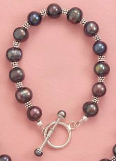 Sterling Silver Bali Beads Toggle Bracelet, 7 inch long, 10mm Peacock Pearls Silver Messages. $82.99. Save 29% Off!