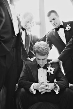 The groom and his guys gather together for a spiritual moment...pray with the groomsmen and fathers