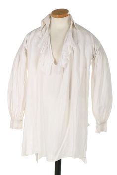 Shirt, 18th century. White linen of voluminous cut, with two buttonholes to collar and flounce to neck opening.