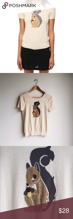 UO Collective Squirrel sweater, size L. Adorable! Ivory fabric with scoop back, ribbed sleeves rubbed hem. Urban Outfitters Tops