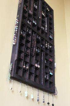 Vertical Printers Drawer Jewelry Display. This uses antique printers drawer hooks, screw eyes, glue, felt, hardware, paint
