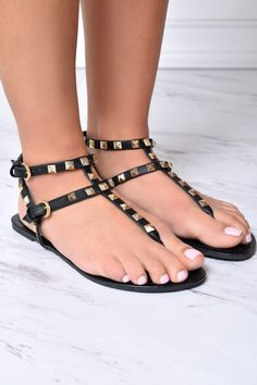 Stay classy l in these sublimely hued shoes. Vegan leather sandals feature a T-strap design with adjustable straps that are embellished with metallic rockstuds. Finished with a textured sole.