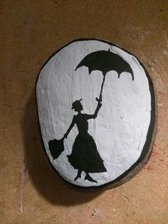 Mary Poppins painted rock.