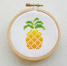 Cross Stitch Pineapple cross stitch patterns - Cross stitched an other of my tea puns patterns, tea rex. You can find the pattern for the tea rex here And I tried out making a backing for the hoop for the first time. Cross Stitch Fruit, Small Cross Stitch, Cute Cross Stitch, Embroidery Hoop Art, Cross Stitch Embroidery, Embroidery Patterns, Easy Cross Stitch Patterns, Cross Stitch Designs, Stitch Kit