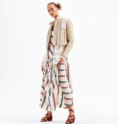 Model wears cropped jacket and maxi dress from H&M Studio's spring 2016 collection