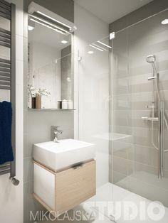 paktyczna mała łazienka z głęboka prostokatną umywalką,kabiną z natryskiem w biało-szarym kolorze - Lovingit.pl