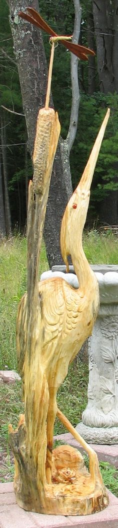 Botley heron carved from a conifer stump and standing over