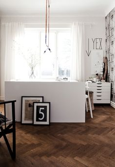 herringbone floors, copper pipes, industrial lighting, bookshelf wallpaper?  this is my dream office!