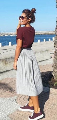 #fall #outfits gray pleated midi skirt and brown short-sleeved shirt and sneakers