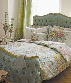 a bit of versailles overload, all together?  maybe.  but these elements taken separately - flowers, headboard, bedspread, or curtains - could add a beautiful counterpoint to a room with more modern influences, too.  (and if you're into the louis XIV-style excess, bring it on and live it up, my friend!)
