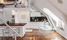 modern window designs for small interiors with an inclined roof