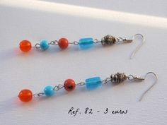 Long earrings in orange and turquoise blue // Brincos compridos em tons de azul e laranja