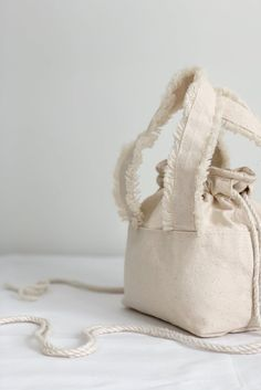 Natural Cotton Canvas Drawstring Bag Frayed Fringe Handbag | Etsy Cotton Canvas, Cotton Fabric, Fringe Handbags, Minimalist Bag, Cotton String, Bucket Bag, Gifts For Her, Handmade Items, Reusable Tote Bags