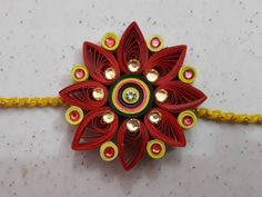 How To Make Quilling Rakhi At Home. In this video we are making quilling lovely Rakhi. In this we are use Toothpick, Fevicol, Colorful Paper Strip, Laces & Stones. This is the easy way to make a Rakhi At Home. So all Lovely Sister can make a Lovely Rakhi Paper Quilling Cards, Paper Quilling Jewelry, Origami And Quilling, Paper Quilling Designs, Quilling Ideas, Quilling Patterns, Paper Jewelry, Quilling Rakhi, Handmade Rakhi Designs