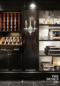 custom wine cellar, mirrored shelving, black cabinetry, wine storage, black marble floors, sconces