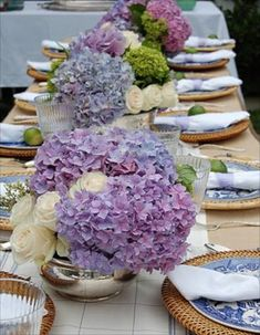 Summer Tablescapes!  Love the combo of the purple hydrangea and  the wicker chargers with blue & white plates!