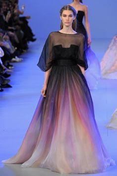 Elie Saab Spring 2014 Couture–For Elie Saab's spring-summer 2014 haute couture collection, the designer found himself inspired by the work of Sir Lawrence Alma-Tadema. The 19th century Dutch painter is known for the way in which he features flowers and textures. Similarly, Saab conjured a detailed-orientated spring outing with a focus on the botanical featuring …