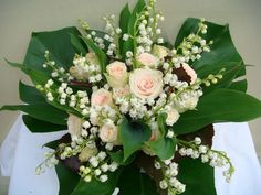 Nice arrangement of Lily of the Valley and roses