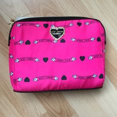 Betsey Johnson pink banner accessory bag Fushia with banner fabric.  Nylon.  Black faux leather accents.  Bought NWOT and protective cover still over the heart. Betsey Johnson Bags Cosmetic Bags & Cases
