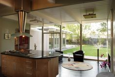 Klopf Architecture's target was to re-design a devoted Eichler family home to suite all five members and their tastes. The plan, keep intact the same street lined single story Eichlers while keeping the neighbors happy and designing a more open useful home. Klopf designed an