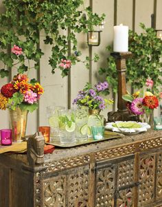 Charming Ideas for Summer Party Table Settings Enliven a side table with wildflowers in vases and bold coloredglass votives Offer slices of lime and fresh herbs to add to. Outdoor Parties, Outdoor Entertaining, Chinese Lights, Outdoor Buffet, Outdoor Tables, Outdoor Ideas, Summer Barbecue, Summer Parties, Summer Drinks