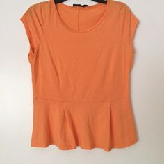 Orange Peplum Top creamy orange top. Looks great casual with jeans or dressed up with a belt and heels The Limited Tops Blouses