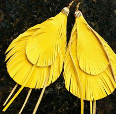Hey, I found this really awesome Etsy listing at http://www.etsy.com/listing/73385002/leather-feather-earrings-sunny-yellow