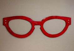 Our latest wall art for an Optometry shop in Nebraska. #glasses #wallart #optical #red #keyhole #display #design