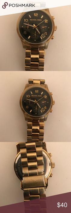 Michael kors boyfriend watch Gold toned Michael kors boyfriend watch. Black face. Light scratches to the face and some of gold tone has worn off of back of watch. Works well, needs a new battery. KORS Michael Kors Jewelry Bracelets